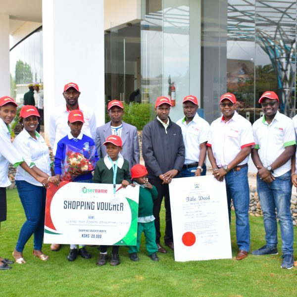 Username-Investment-Ltd-Team-together-with-Musa-Yatich-and-Wamo-Non-Formal-Education-Centre-children-after-awarding-them-a-free-residential-plot-and-shopping-voucher-as-Valentine's-gifts-respectively
