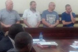 Four British 'anorak' plane spotters arrested in Kenya over terror offences for taking snaps of take-offs as they sat in an airport pub