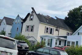 Multi-alarm fire in Lowell apartment building spreads to neighbouring home