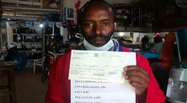 Kenyan Man Writes Sh10,500 Personal Check to President Uhuru for Combating Covid-19