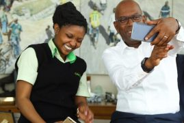 Safaricom attendant who touched customers' hearts meets Bob Collymore