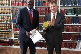 Photos Video: C.J Hon David Maraga Hands over a copy of the Kenya Constitution to Prof. William Alford, Vice-Dean at Harvard Law School,Cambridge Massachusetts