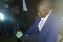 Man with oxygen tank turns up to vote